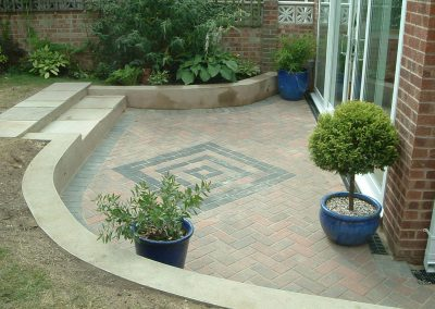 Patio with curved wall, steps and diamond feature, Cudworth, Barnsley