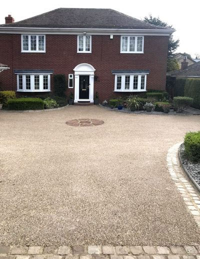 Resin driveway with brick edge and central feature