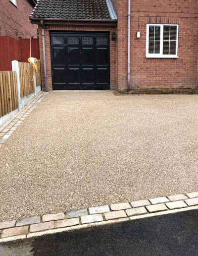 Resin driveway with brick set edge detail